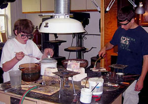 students working at soldering bench